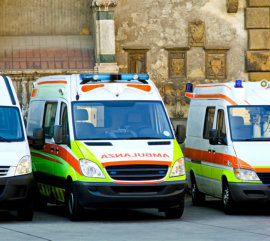 Ambulance paramedic team with several emergency vehicles.